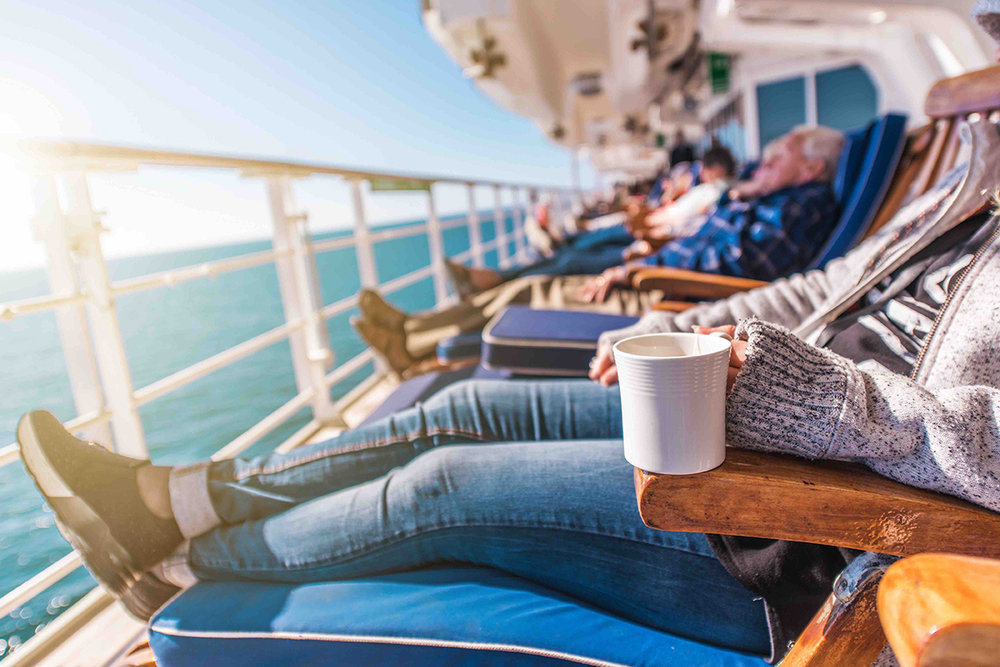 relaxing on deck of cruise ship_sm.jpg