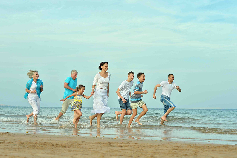 Family running on the beach.jpg