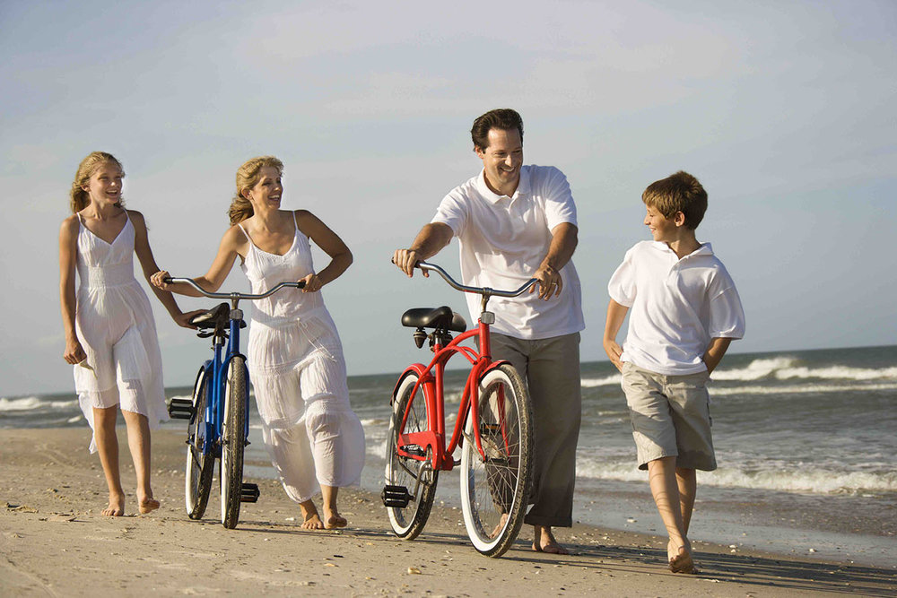 family biking on the beach.jpg