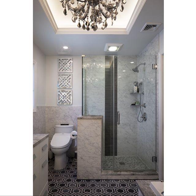 Doesn't everyone need a crystal chandelier in their bathroom? #chandelier #crystal #interiordesign #bathroomremodel #marble #love