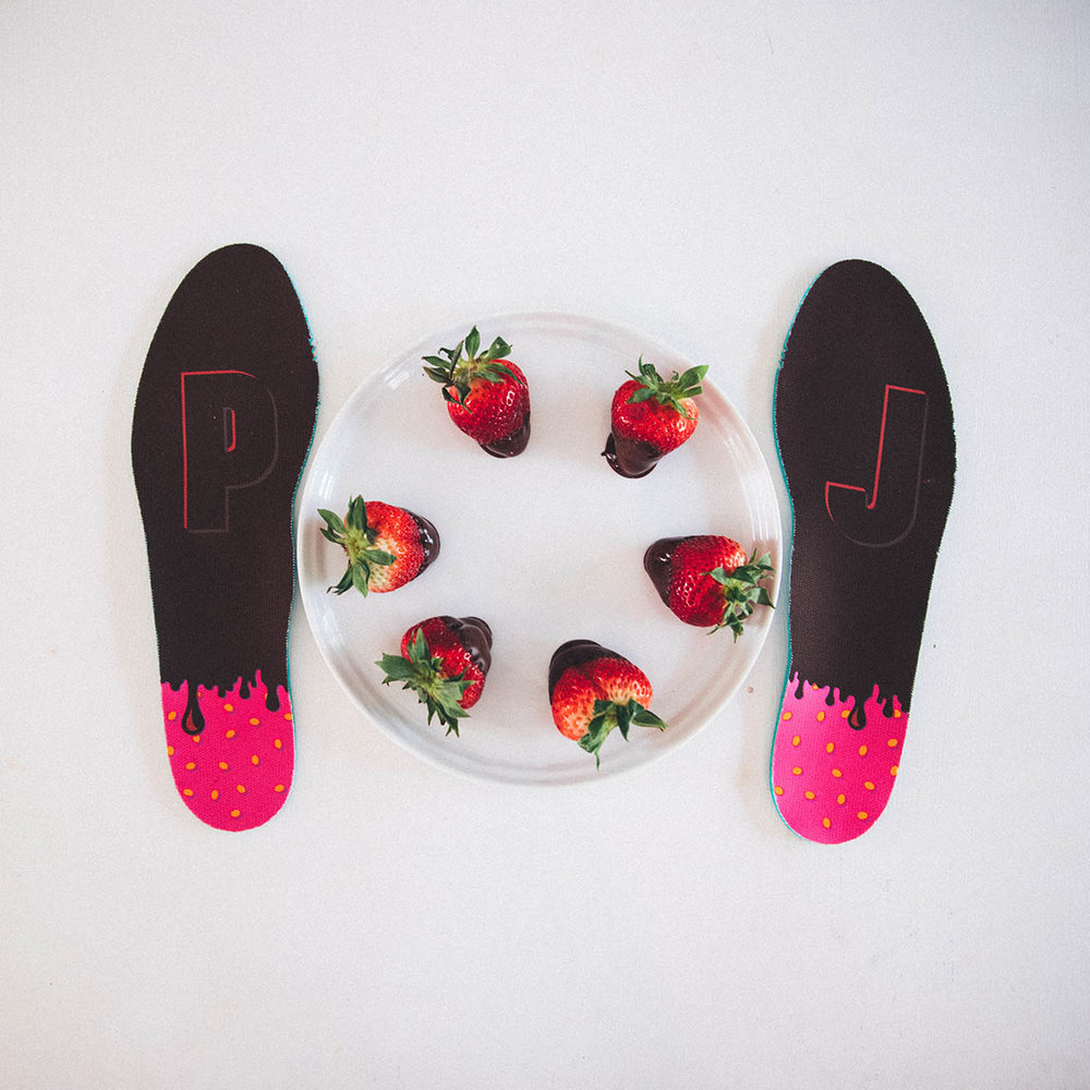 - We see the dipped strawberry on the tongue of the cleats and sockliner which also features his mom's initials, PJ.