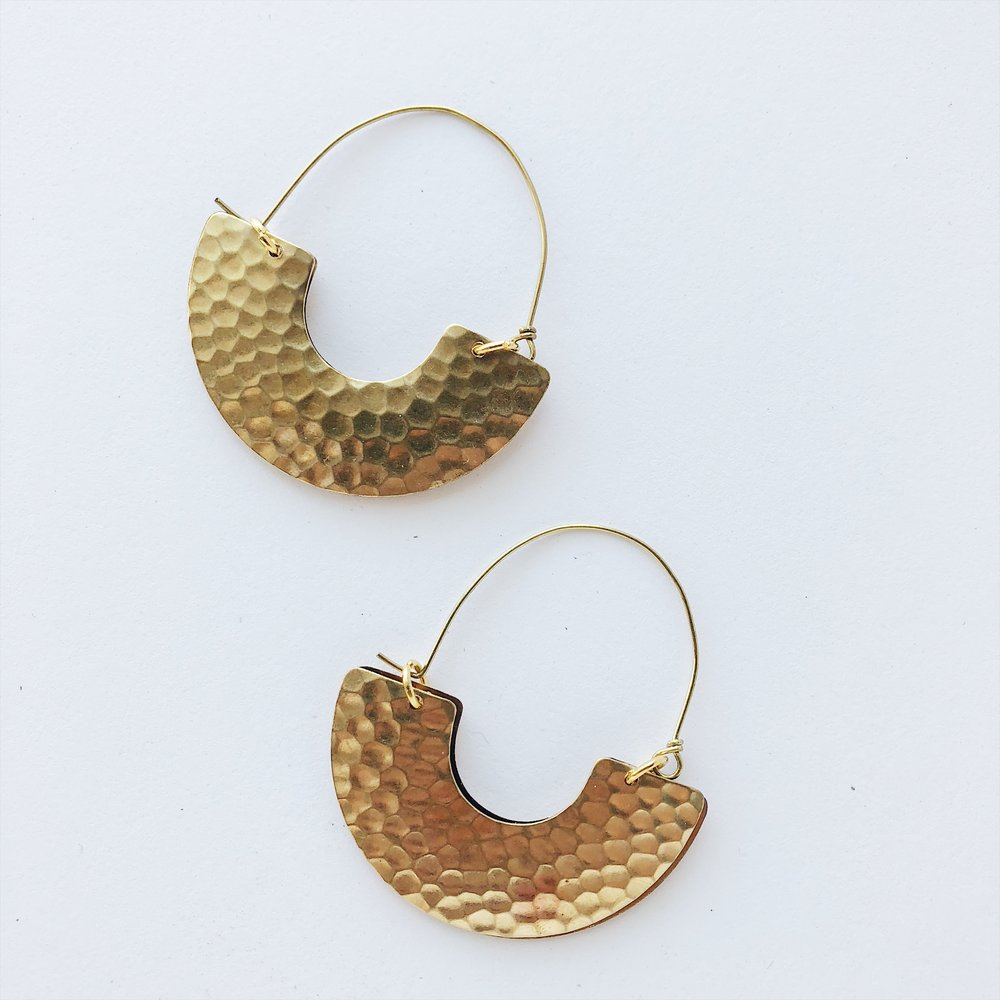 Add a Moroccan edge to your getup with these hammered-brass U-shaped hoops. They'd look amazing with a high bun and a low neckline.