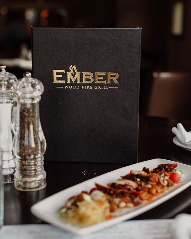 """At Ember, we encourage sharing: the most social and economical way to dine. Our style is not the traditional """"Soup, Salad, Appetizer, and then Entrée."""" Instead, we strive to be fresh, simple, and unique. 🍴  All of our food is prepared fresh and is designed to be served when it is ready. Order a few dishes to split amongst your party!  Join us during the summer months at our outdoor dining patio or outdoor bar for free musical entertainment 🎶"""