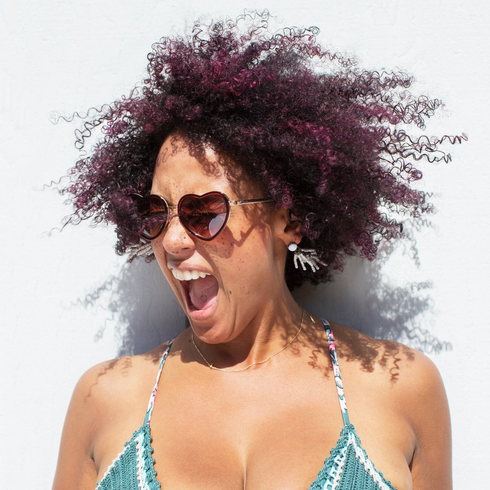 Chloe Jackman    Workshop & Cabin Leader    Chloe  is a sassy San Franciscan with attitude. On any given day you'll catch her sportin' cheetah, stripes, turquoise or gold (sometimes all at once) rocking her #FrecklesnFro and dancing on the job. Did she mention she's a native? Native San Franciscan, that is.   She can't wait to find unicorns in the forest.