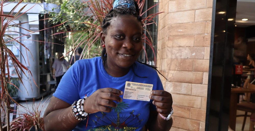 Rose is from Haiti and she came to Brazil under a special humanitarian visa program. She now has permanent residency and couldn't be more grateful! Here she is holding up her Brazilian permanent residency card. Rio de Janeiro, 28 April 2018.