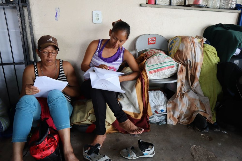 Women filling in their asylum registration paperwork, at shelter in Boa Vistsa.