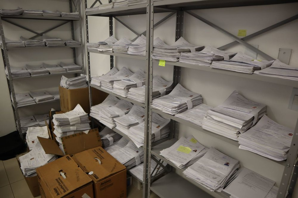 Stack of asylum applications waiting to be processed by Brazilian Federal Police in Boa Vista.