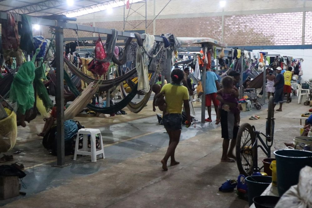 Warao Indigenous community shelter in Boa Vista. At the request of the community UNHCR provided this massive frame where they can string up hammocks. This shelter is very over crowded with around 600 people in one building.