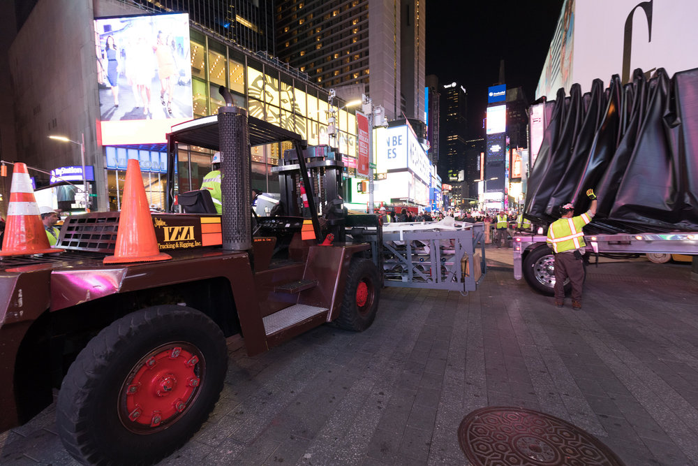 Izzi Trucking & Rigging  recently completed an extremely time sensitive hauling and rigging project for a new store in the center of in Times Square, NYC. Working around thousands of people, safety naturally was our top priority.This project took special coordination and specialized equipment to successfully work around this busy environment. The Izzi Group will provide the expertise needed for your job too, contact us to find out more information.