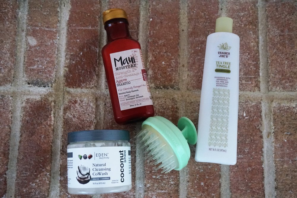 Eden Bodyworks: Natural Cleansing CoWash (Walmart), Maui Moisture: Agave Shampoo, Vanity Planet: Groove Scalp Massager (VanityPlanet.com), Tea Tree Tingle Conditioner: Trader Joes