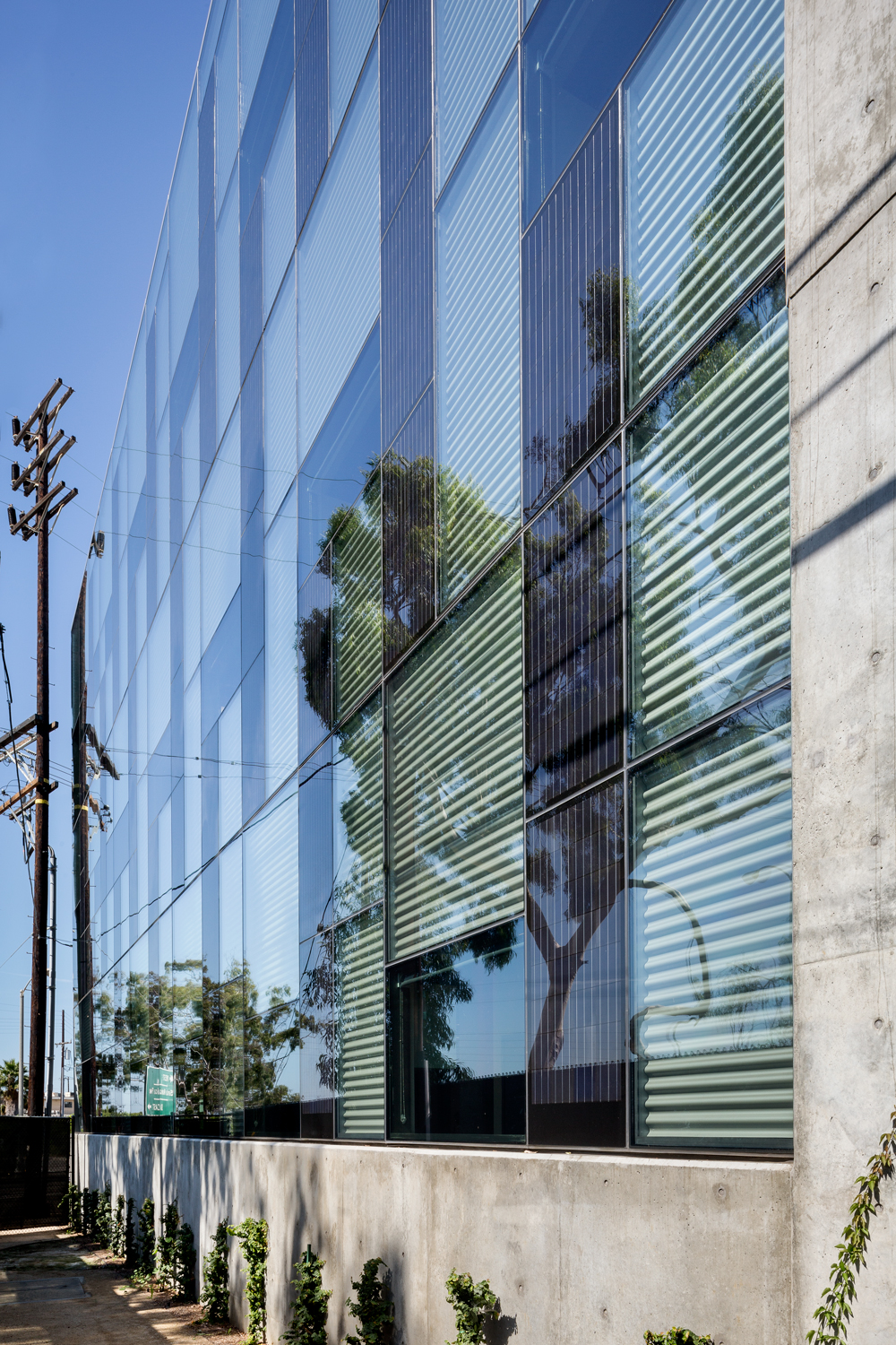 Photovoltaic Panels gather solar energy and use it to power the building