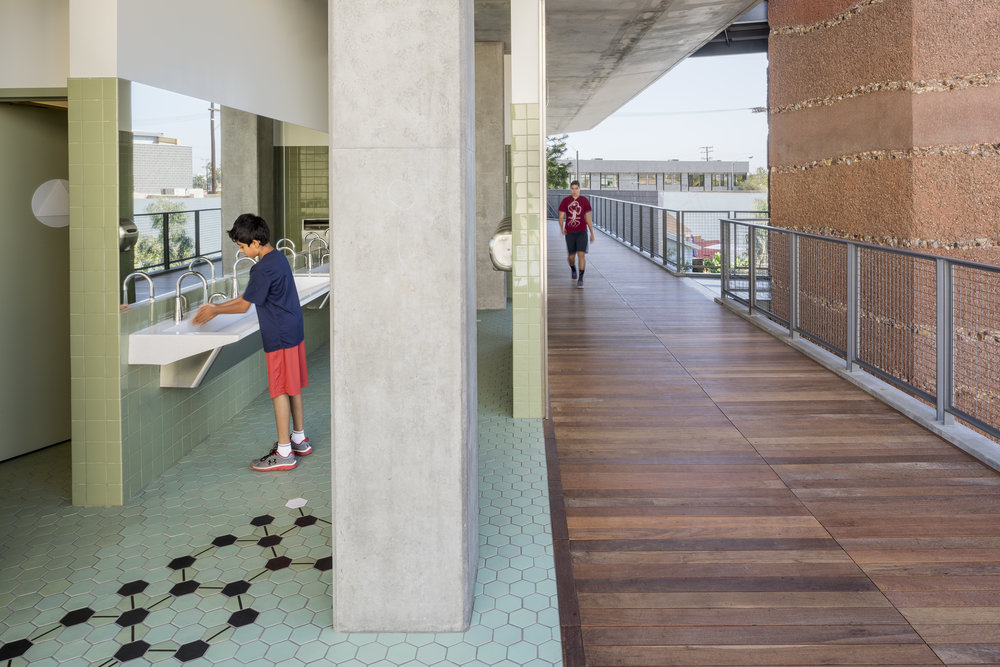 At Crossroads, inclusivity is a way of life - molecular structure tile patterns lead the way to the all gender restrooms