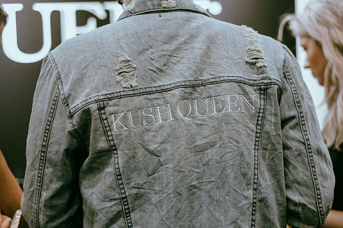 "Back of denim jacket reading ""Kush Queen"""