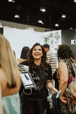 Kush Queen Founder, Olivia Alexander, pictured at booth during first exhibition of hemp brands at BeautyCon.