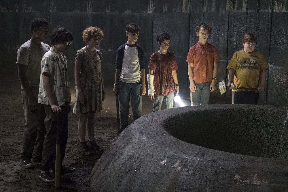 From left to right: Chosen Jacobs,  Finn Wolfhard, Sophia Lillis, Jaeden Lieberher, Jack Dylan Grazer, Wyatt Oleff, and Jeremy Ray Taylor in  It