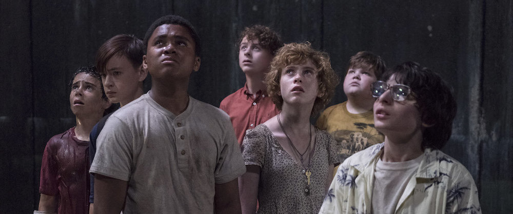 From left to right:  Jack Dylan Grazer , Jaeden Lieberher,  Chosen Jacobs ,  Wyatt Oleff , Sophia Lillis,  Jeremy Ray Taylor  , and  Finn Wolfhard  in  It
