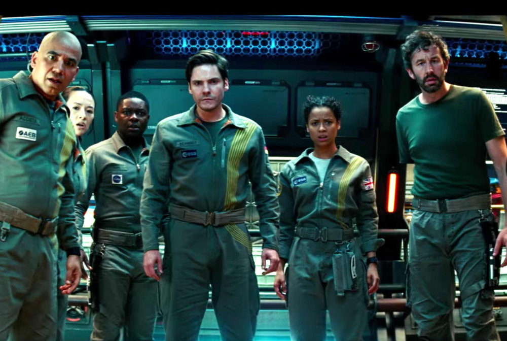 From left to right: John Ortiz, Zhang Ziyi, David Oyelowo, Daniel Brühl, Gugu Mbatha-Raw, and Chris O'Dowd in  The Cloverfield Paradox