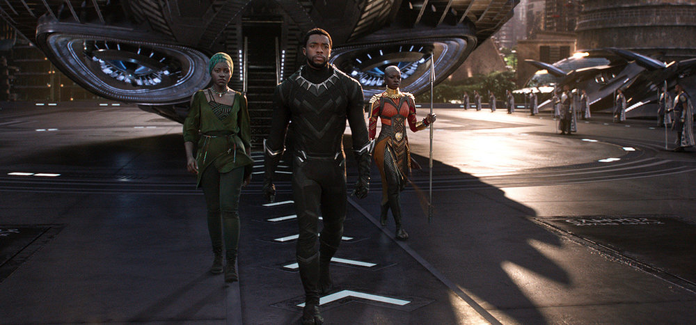 From left to right: Lupita Nyong'o, Chadwick Boseman, and Danai Gurira in  Black Panther