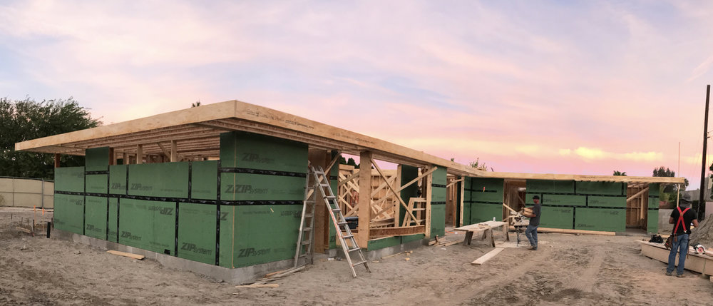 turkel_design_modern_prefab_home_axiomdeserthouse_assembly_sunset.jpg