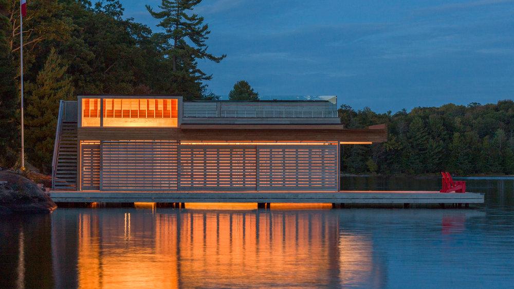 turkel_design_modern_prefab_home_muskoka_boathouse_evening.jpg