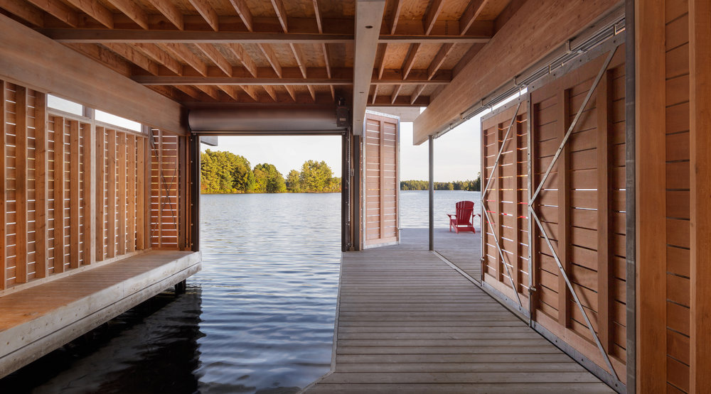 turkel_design_modern_prefab_home_muskoka_boathouse_doors_halfway_closed.jpg