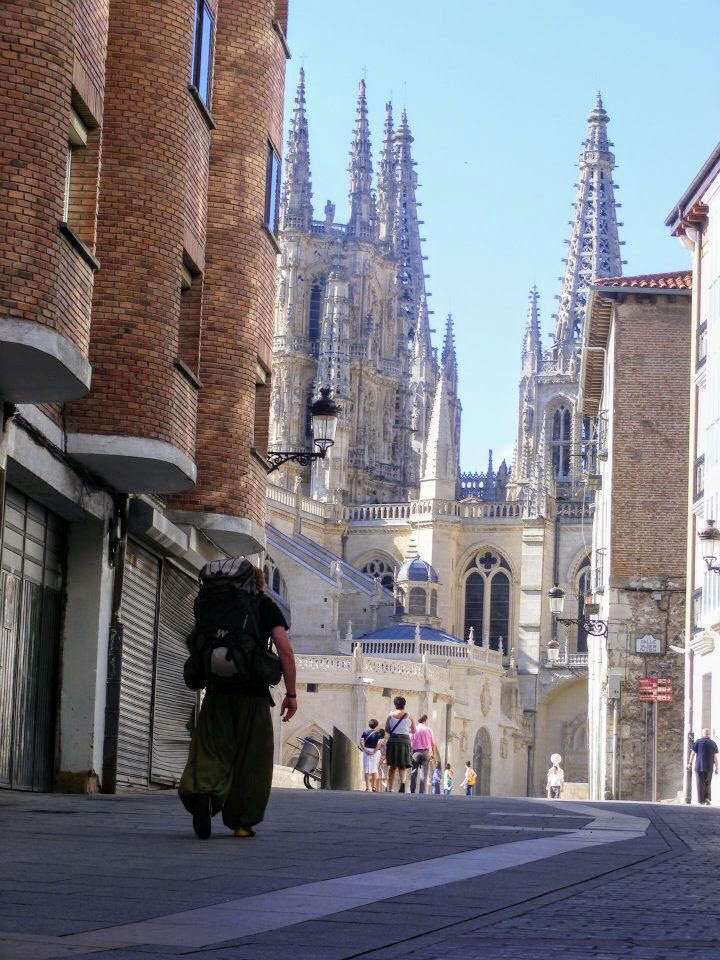 Matt backpacking in the city of Burgos, with the cathedral spires in the background