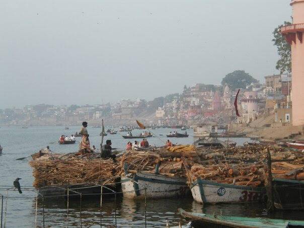 Wood for the funeral pyres on boats, the River Ganges, Varanasi