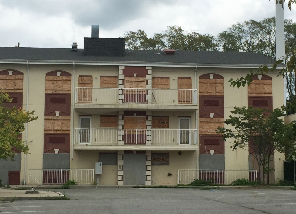 This Main Street residential complex had so many code violations during its construction phase that it never received a certificate of occupancy.  It too has stood vacant and boarded up for years. Good news is, a new developer has cleared existing violations.