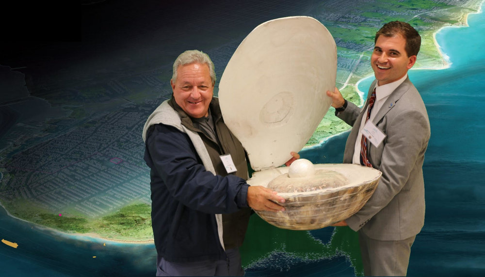 Malizia and Alex Zablocki, former senior project manager with the Governor's office of storm recovery, pose with a giant oyster, a map of the Living Breakwaters site in the background.