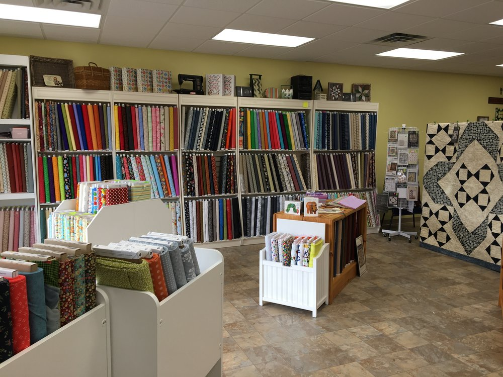 Fabrics and Notions - Topstitchery has a well curated selection of quilting fabric, fat quarters, and extra wide backs. We also carry a range of notions and patterns.