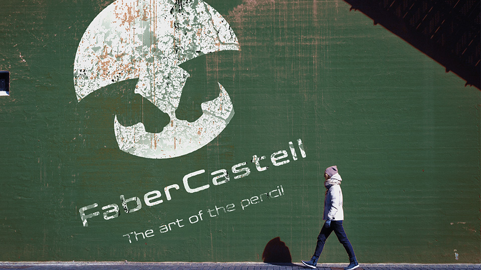 The redesigned FaberCastell identity painted on the side of a building.