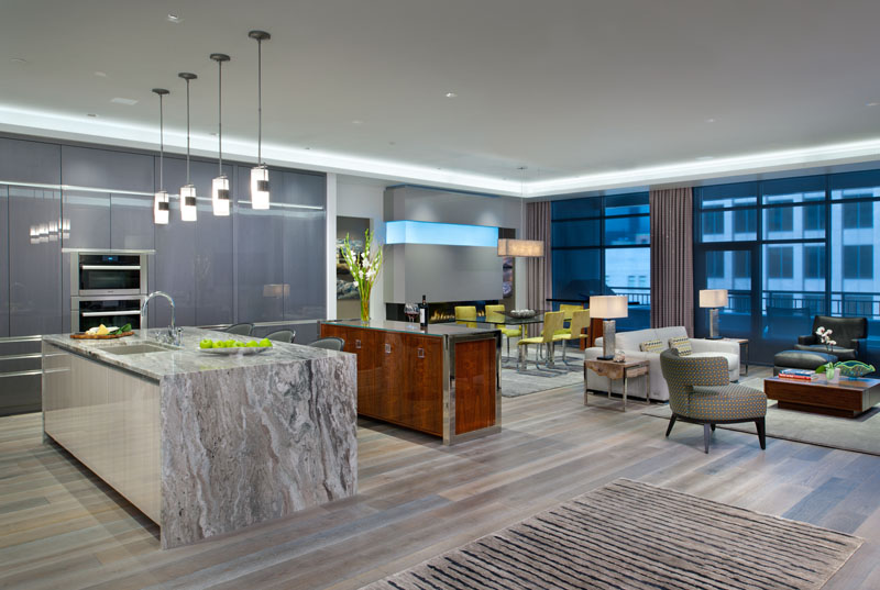 It is important to create a cohesive and continuous look. This can be achieved through a single flooring material, color palette and cabinetry choices. Designed by KBC Pittsburgh.