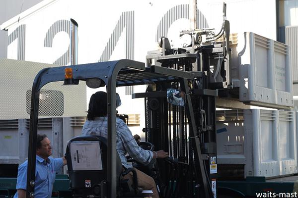 Waits-Mast winemaker Shalini Sekhar loads empty bins onto Mariah Vineyards' owner Dan Dooling's truck. Photo: J. Waits/Waits-Mast Family Cellars