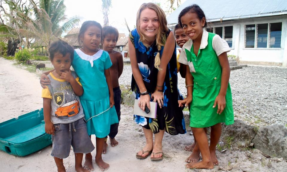 Janice Cantieri, freelance writer and researcher, pictured with I-Kiribati children.