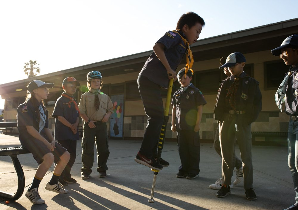 "Paige, left, plays with her fellow Scouts before their Scouts BSA graduation ceremony in San Jose on May 16, 2018. Pack 317 was one of the first in California to integrate girls into their program following the rebranding of Boy Scouts to ""Scouts BSA"" last fall."
