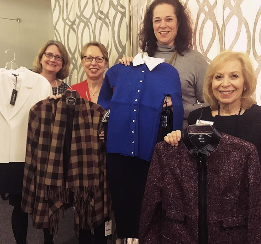 Outfit of Opportunity - Norden, Bottomless Closet staff and volunteers all smiles with new corporate donations.