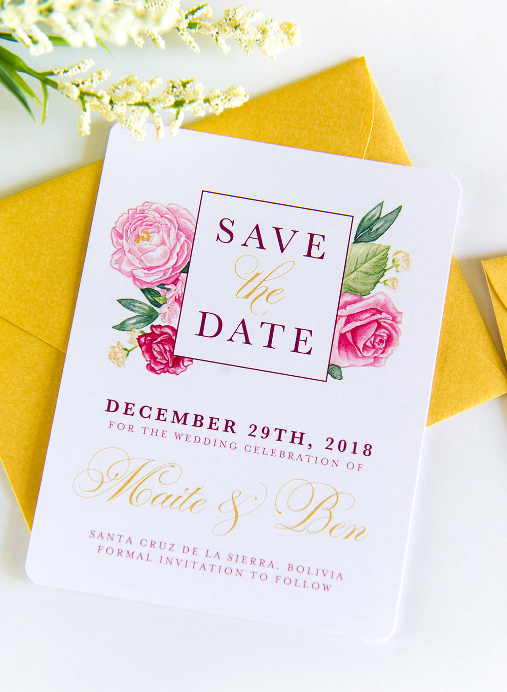 Floral Save the Date - This floral Save the Date was inspired by the couple's wedding flowers and colors. With a matching gold envelope, custom gold shimmer in the flowers and a matching return address stamp, this design came together beautifully!With versions in both English and Spanish to accommodate all guests and a matching, fun and trendy Bachelorette Party Invite, we just love how the hand painted watercolor florals unite their wedding stationery.