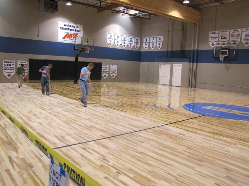 gym-floor-applying-finish-1.jpg