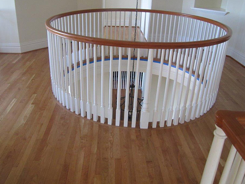 red-oak-circle-stair-railing.jpg