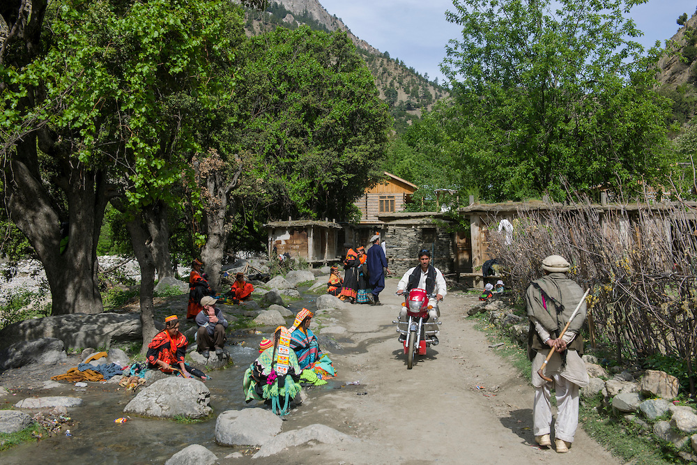 Kalash girls washing clothes in a stream at Balangur Village, Rumbur Valley, Chitral.jpg