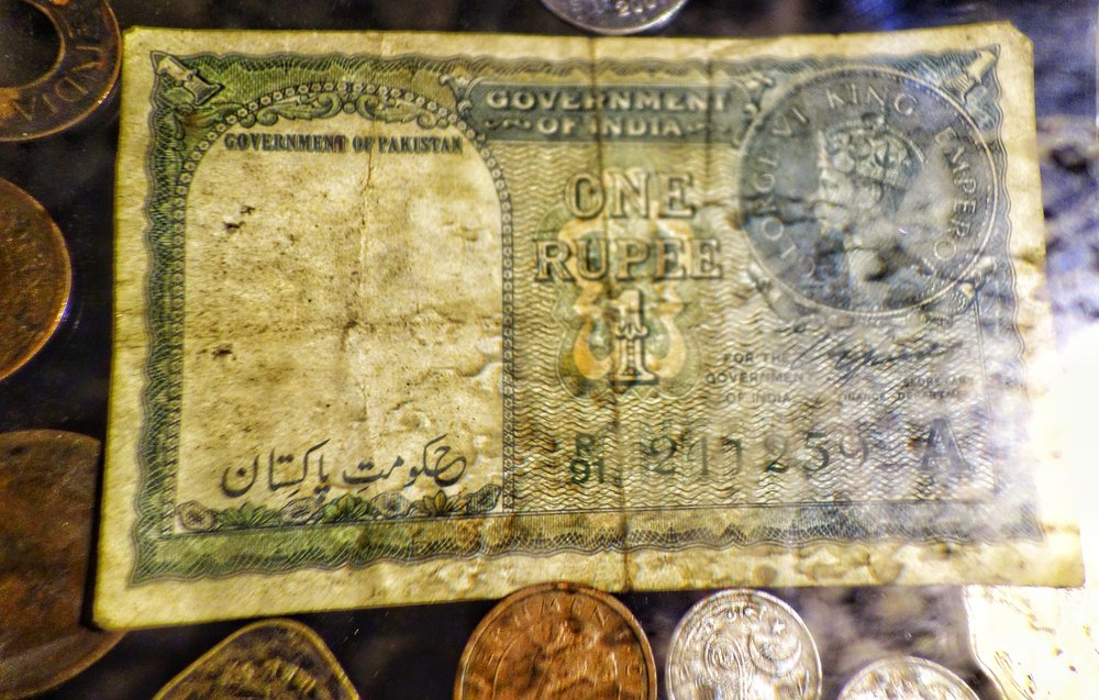 A One Rupee Note from the time of Independence which was legit currency in India and Pakistan