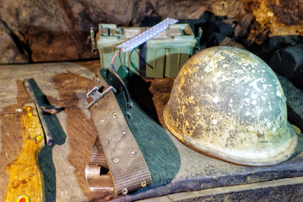 A Old Pakistani Belt and Helmet left over from the 1971 war. Also a Toy gun.