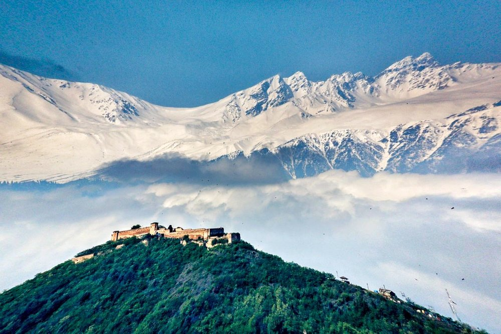 The Hari Parbat Fort in Srinagar with the Pir Panjals in the background.