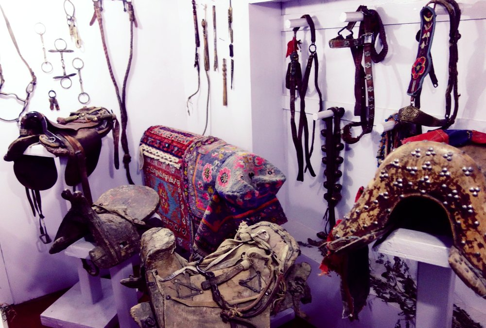 Horse Saddles from various Central Asian Countries at display at the Munshi Aziz Bhatt Museum, Kargil