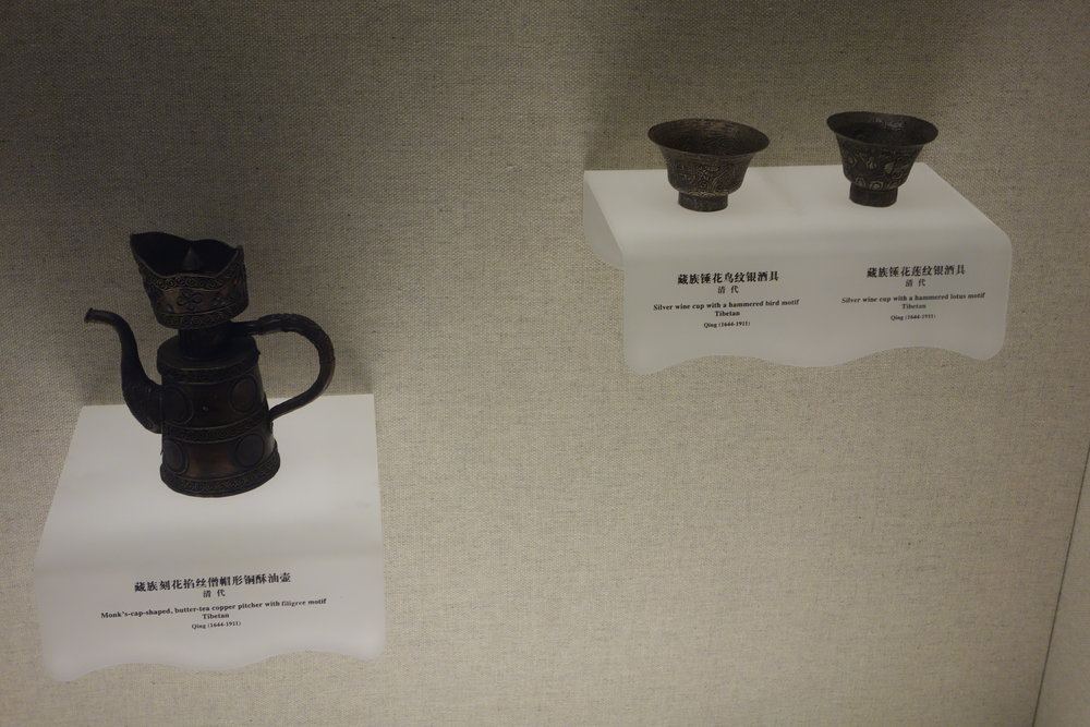 Left : Monk's Cup Shaped Butter Tea Copper Pitcher with filigree Motif. Mid Right : Silver Wine Cup with a hammered Bird Motif. Right : Silver Wine Cup with a Hammered Lotus Motif