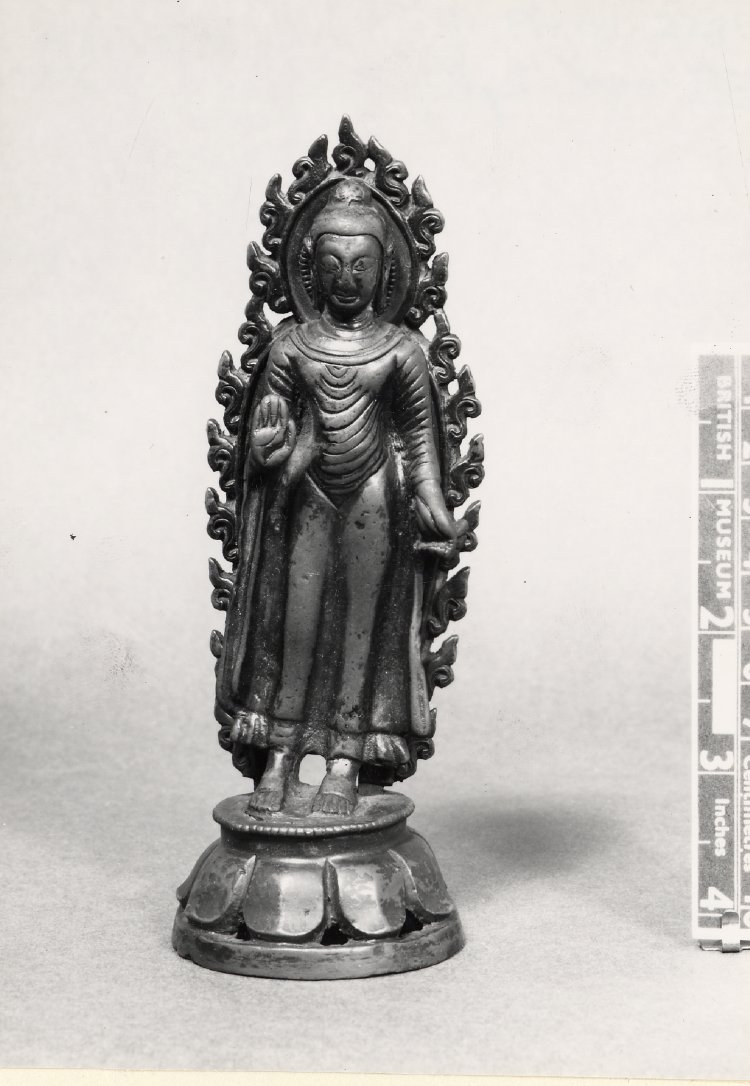 Figure (Buddha). Standing on lotus. Made of bronze. 10th C - 11th C