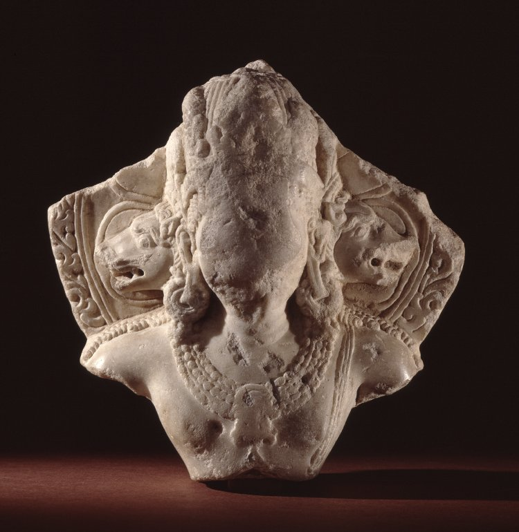 Figure (Viṣṇu.fragment). With boar heads on shoulders,earring and necklace,worn. Made of marble (white). 9thC-10thC