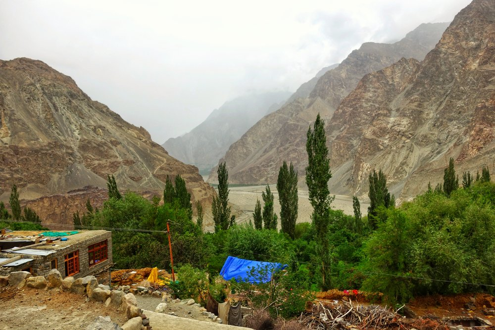 The Green patch in the distance at the bottom of the Mountains is the first Village, Phranu on the other side.