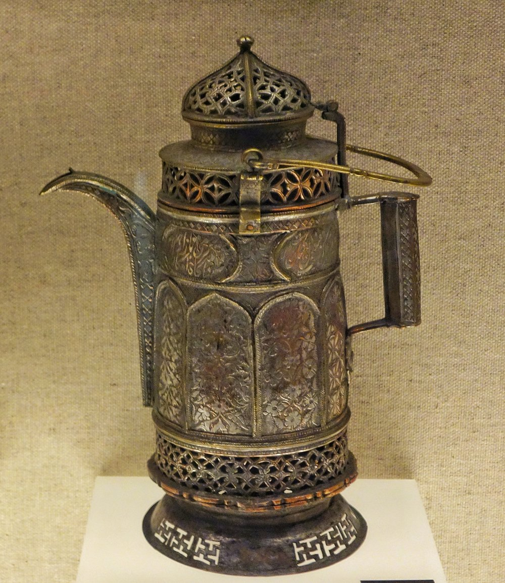 Ughyur Copper Pitcher with an openwork design and a Looped Handle