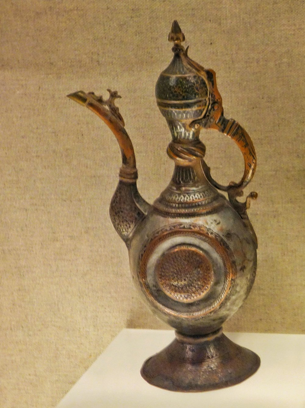 Ughyur Copper Pitcher with a Carved Motif and a Lacquered Inlay-01.jpeg